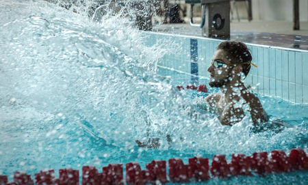 waterpool: Swimmer man. Happiness swimming athlete in goggles after distance in waterpool. Stock Photo