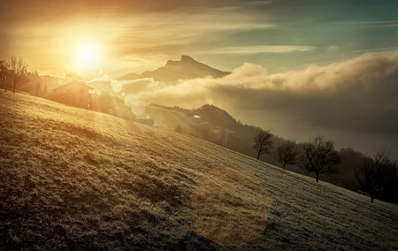 sunlight sky: Beautiful Mountains view at morning. Sunrise in austrian mountains at morning time. Sunlight and cloudy sky. Stock Photo