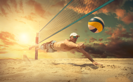 sunny beach: Beach volleyball player in action at sunny day under blue sky. Stock Photo