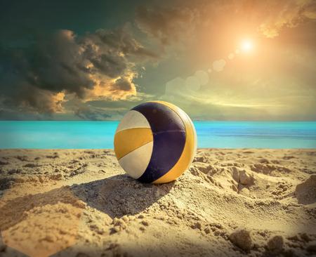 sunlight sky: Beach Volleyball. Game ball under sunlight and blue sky.