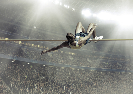 man flying: Athlete in action of high jump.