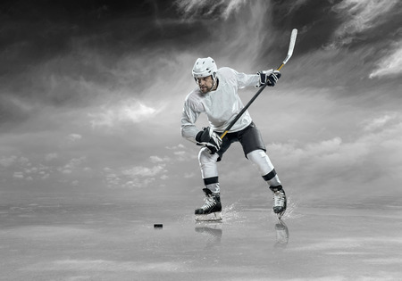 frozen lake: Ice hockey player on the ice