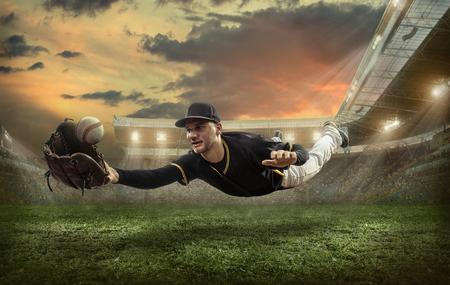 Honkbal spelers in actie op het stadion. Stockfoto