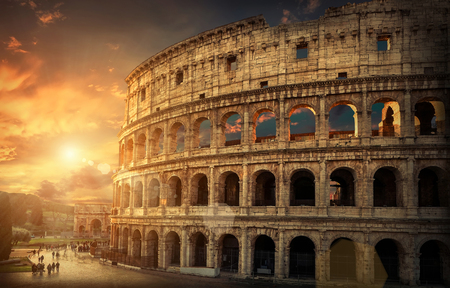 most popular: Rome, Italy.One of the most popular travel  place in world - Roman Coliseum under evening sun light and sunrise sky.