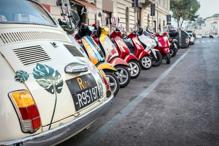ROME - JANUARY 07: Old car and retro scooters on January 07, 2017 in Rome. Scooters are the symbol of Rome - most popular historical travel place of the Italy and the world. Stok Fotoğraf - 80969435