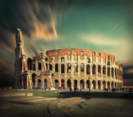 Rome, Italy.One of the most popular travel  place in world at sunny day - Roman Coliseum under sun light with blue sky.