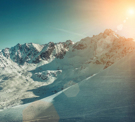 Nice mountains view at sunny day with skiers under blue sky with sun light at winter time. Stock Photo - 89943026
