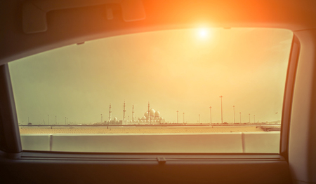 View from car window on the Mosque of Sheikh Zayed in Abu Dhabi, UAE. Stock Photo