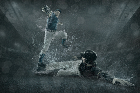 Baseball players in action under water Stock Photo