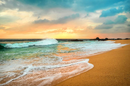 Beautiful Tropical Sea view under sunset sky at Sri Lankain beach. Stormy waves in evening time. 스톡 콘텐츠