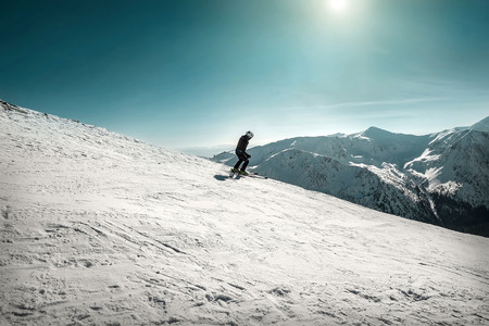 Nice mountains view at sunny day with skiers under blue sky with sun light at winter time. Stock Photo - 97215732