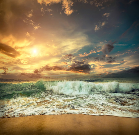 Beautiful Tropical Sea view under sunset sky at Sri Lankain beach. Stormy waves in evening time. Stock Photo