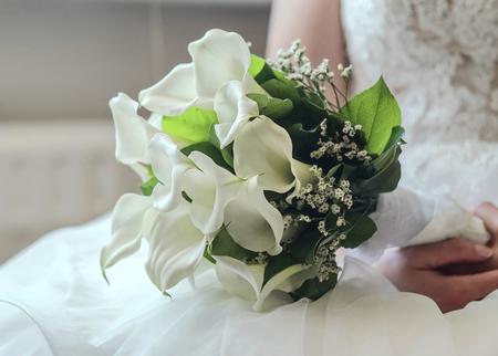 Wedding white flowers on the white dress.