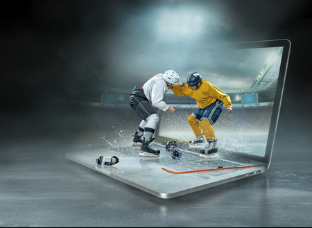 Caucassian ice hockey Players in dynamic action in a professional sport game play on the laptop in hockey under stadium lights. Reklamní fotografie
