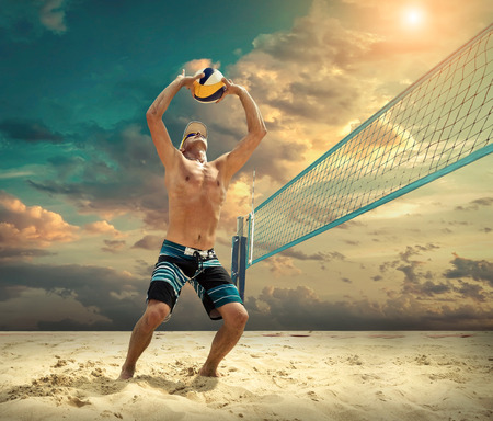 Beach volleyball player in action at sunny day under blue sky. Reklamní fotografie