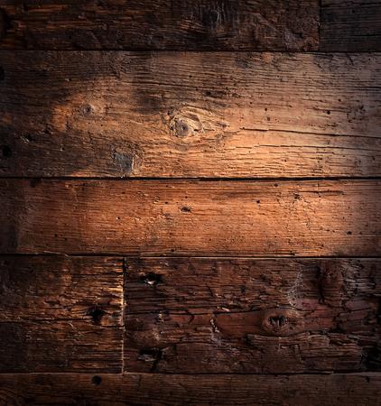 Grunge aged wooden textured background under light. Natural wood in vintage style, design retro desk. Reklamní fotografie