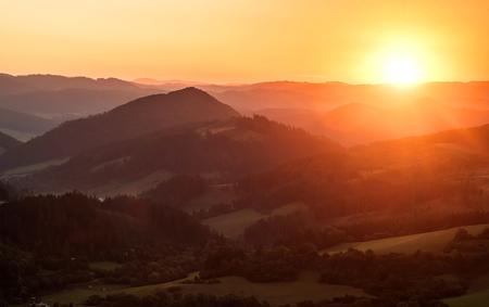 Beautfull sunset view around mountains. Sunlight on the sky with sun and cloud. Reklamní fotografie