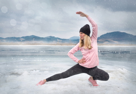 Running woman. Runner on the snow in winter sunny day. Female fitness training outdoors. Sport concept.