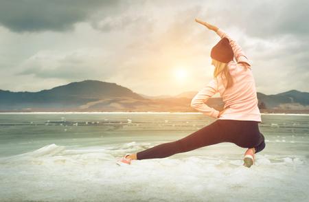 Running woman. Runner is jogging in winter day. Female fitness training outdoors Reklamní fotografie