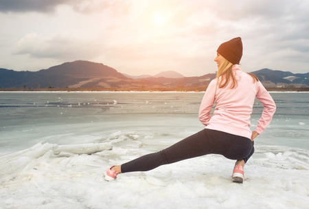 Running woman. Runner is jogging in winter day. Female fitness training outdoors. Sport concept