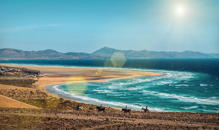 Beautiful panoramic view on the ocean coastline near mountains at sunny day. Travell, jorney,islands, nature, freedom concept.