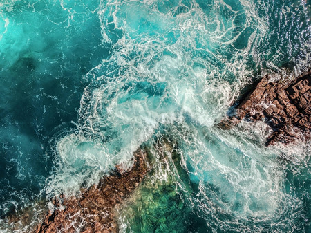 Beautiful aerial birds eye view on ocean waves, Fuerteventura island. Aerial shooting seascape coastline at sunny day. Travell, Beach,islands, Nature, freedom concept. Stock Photo