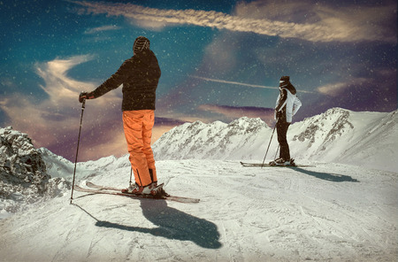 Men and Woman on the ski before sport action at sunny day around mountains under blue sky. Stockfoto