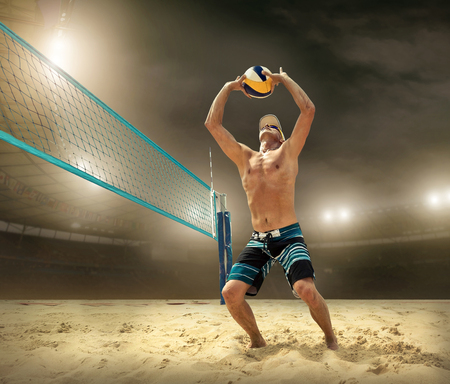 Beach volleyball player in action at sunny day under blue sky. Stockfoto