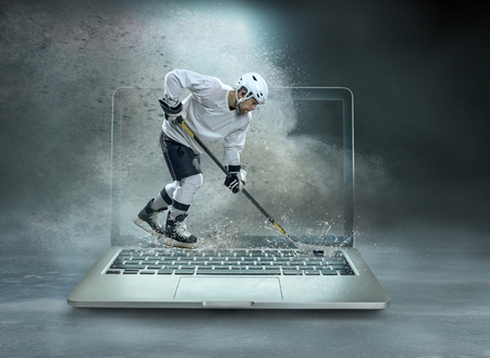 Caucassian ice hockey Players in dynamic action in a professional sport game play on the laptop in hockey under stadium lights. Stock Photo - 123219278