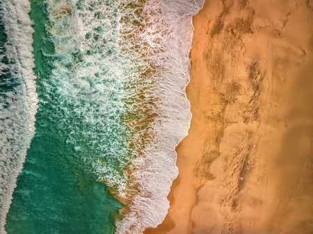 Beautiful panoramic birds eye view on ocean waves, Fuerteventura island. Aerial shooting seascape coastline at sunny day. Travell, Beach,islands, Nature, freedom concept. Reklamní fotografie