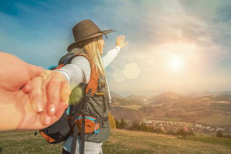 Happy traveler woman tourist stay on the green grass on the peak of mountain and look on the nice fog view. Concept follow me freedom.