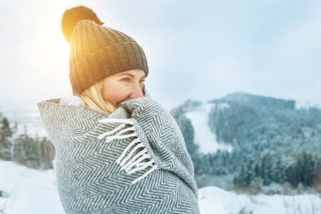 Portrait Happy woman traveler on the top of mountain and looking on beautiful winter snowy view. Standard-Bild