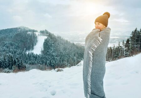 Portrait Happy woman traveler on the top of mountain and looking on beautiful winter snowy view. Zdjęcie Seryjne