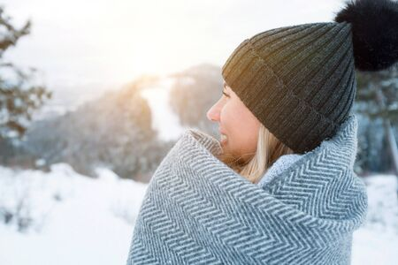 Portrait Happy woman traveler on the snowy of mountain look on the nice winter view in sunny cold day Zdjęcie Seryjne