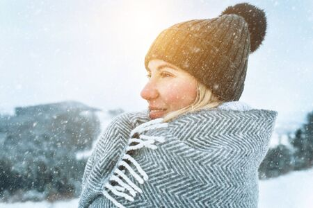 Happy woman traveler on the snowy of mountain look on the nice w