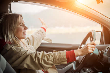 Young stylish woman driving car. Travel, Holidays, Journey, Trip, Lifestyle concept. Health care, authenticity, sense of balance and calmness.