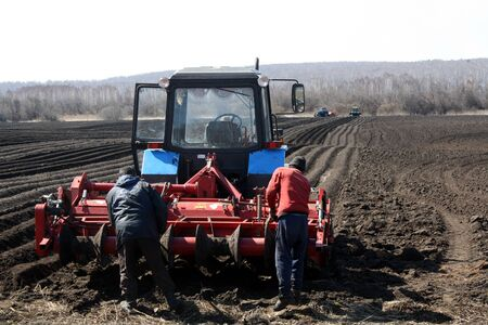 MOSCOW - MAY 2, 2019 field work on the preparation of land in the spring for sowing. The black earth moves away into perspective Editöryel
