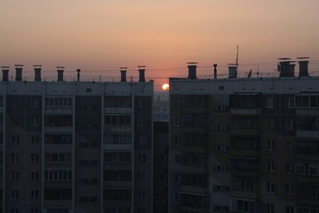 Evening sunset in the city among high-rise buildings