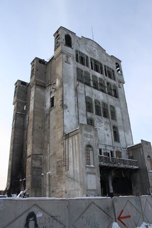 Old abandoned flour mill building Russia