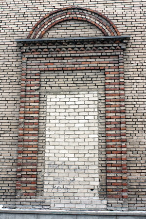 RUSSIA - OCTOBER 30, 2013 A large brick window in a Soviet building of gray-brown color Editöryel