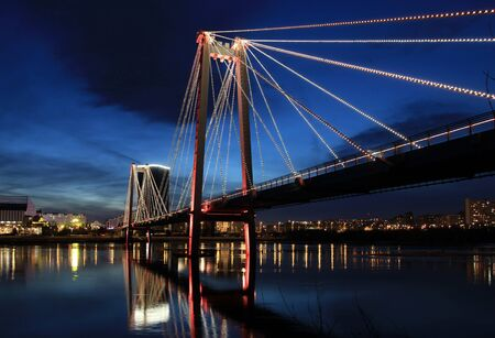 Night Krasnoyarsk. Vinogradovsky bridge over the Yenisei.