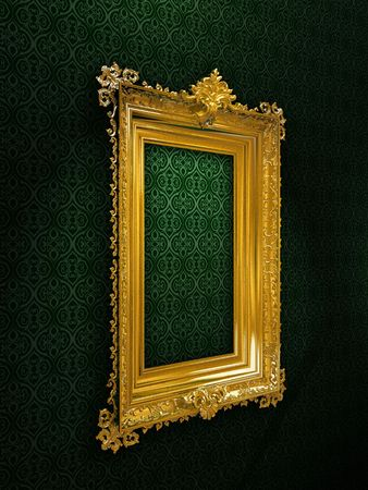 Gold plated and richly decorated frame on a wall photo
