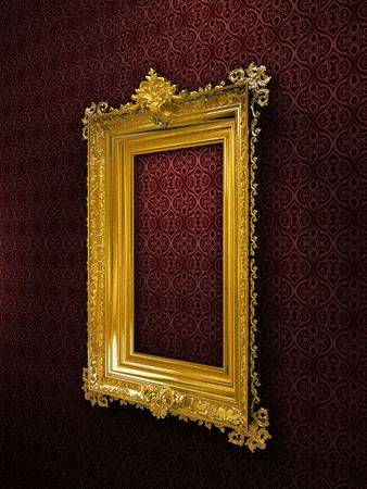 Gold plated and richly decorated frame on a wall