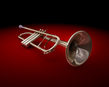 A brass colored trumpet on dark background Stock Photo - 9509047