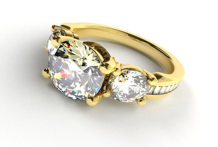 vows: Gold ring with diamonds on a white background