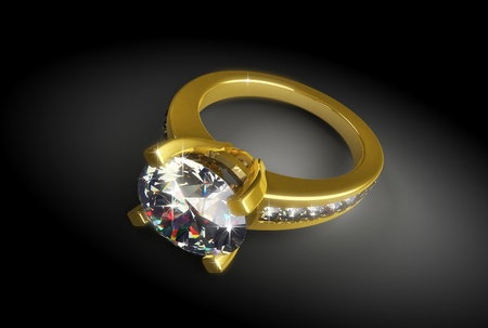 gold ring with a diamond on a black background photo