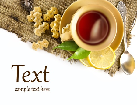 A cup of tea with lemon and crackers Stock Photo - 11972915