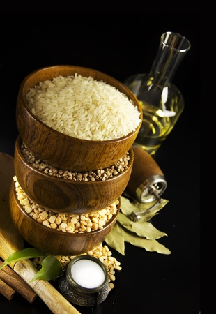 rice mill: Ingredients for cooking on a black background