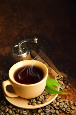 hot coffees: cup of coffee, coffee grinder and cinnamon