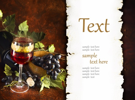 vino:  glass of wine with grapes (With sample text) Stock Photo